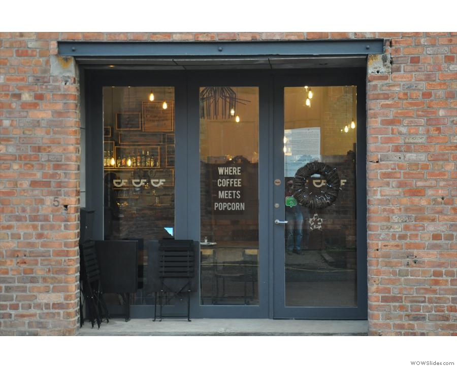 'Where Coffee Meets Popcorn' says the door... Where coffee meets what?