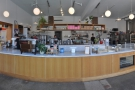 Most of the space is occupied by the large, impressive counter and the bakery behind it.