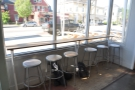 There's also seating here, a row of six stools at a window-bar to the left of the door.