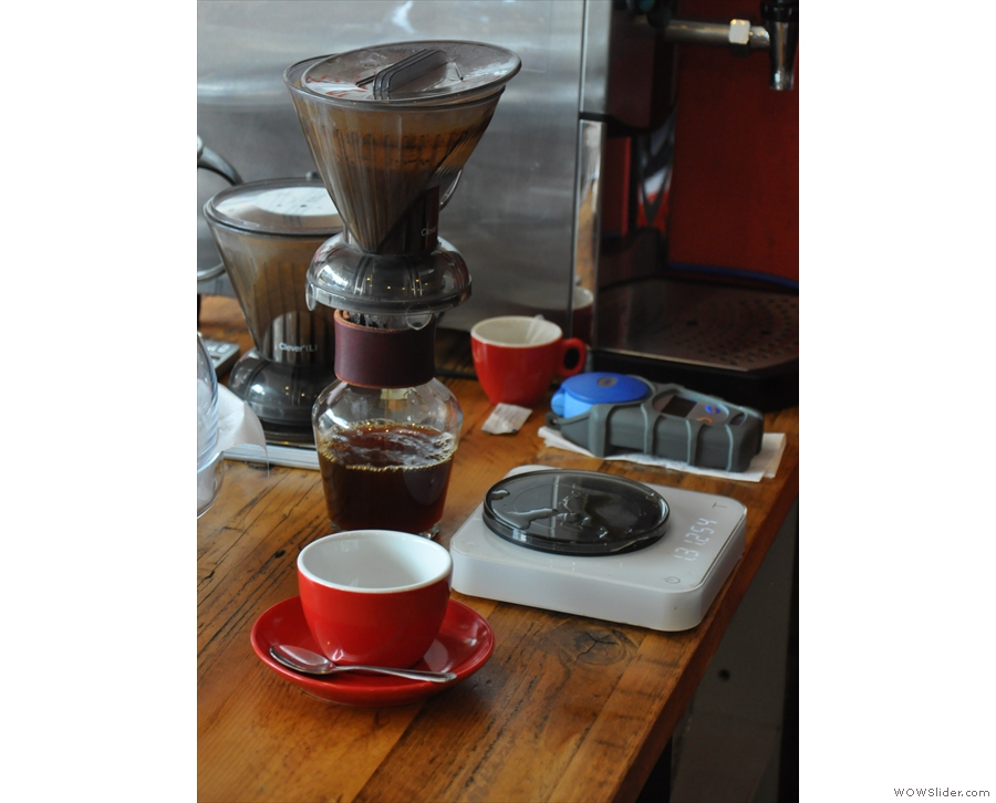 ... which then filters through the bottom. The coffee's served in a carafe, cup on the side.