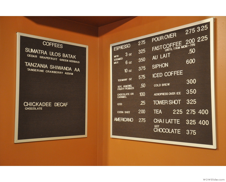 The coffee beans on offer are at the back, next to the concise drinks menu.