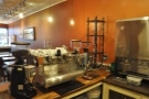 The two-group Synesso, with its grinders, plus the cold-brew apparatus, face the front...