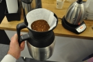 Step 2, fit the filter paper and fill with ground coffee (roughly a V60 grind)