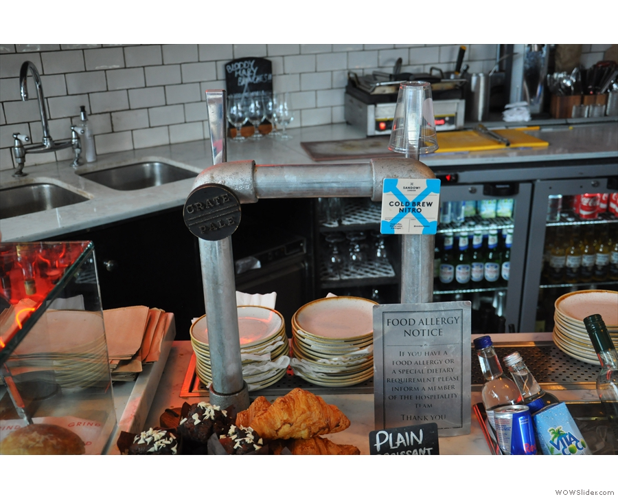 Towering above the cake are the taps for the draft beer and draught cold brew...