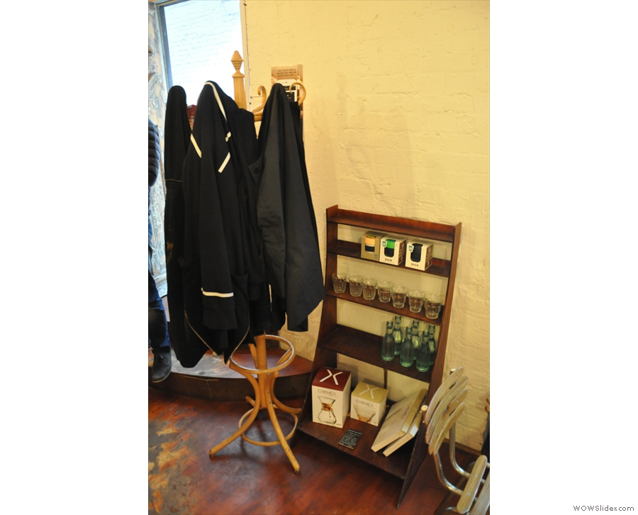 ... as does the coat stand by the door. The water bottles are a nice touch too. Help yourself.