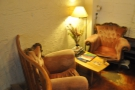 Plus there are two comfy armchairs and a coffee table in the far corner, opposite the door.
