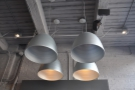 ... with lots of industrial-style lighting. These hang in the raised area to the right of the lobby.