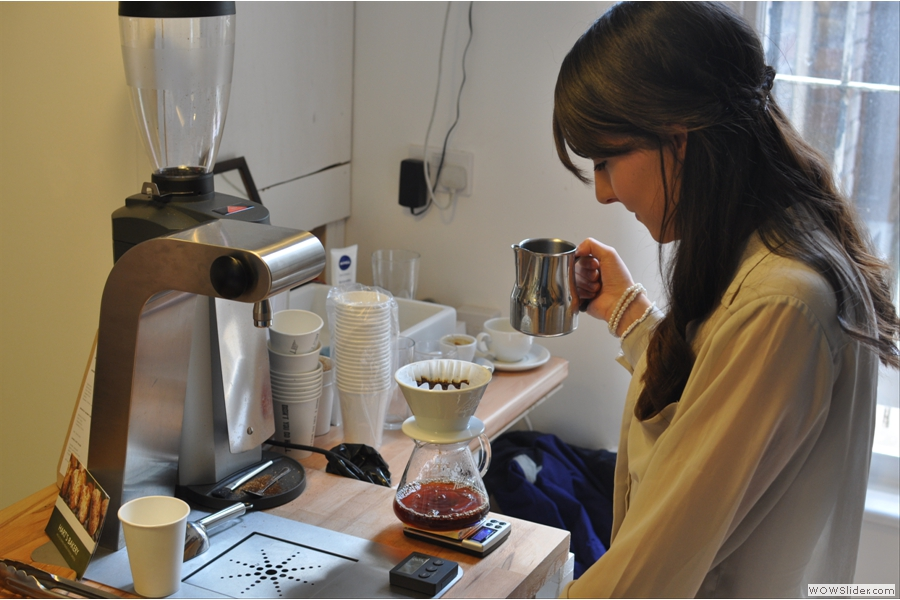 Not to be outdone, here is Ally at work at the Brew Bar. Once again, precision is everything, with the brew being weighed and timed to perfection.