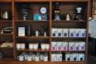 The coffee is part of a set of retail shelves, seen here along with coffee kit...