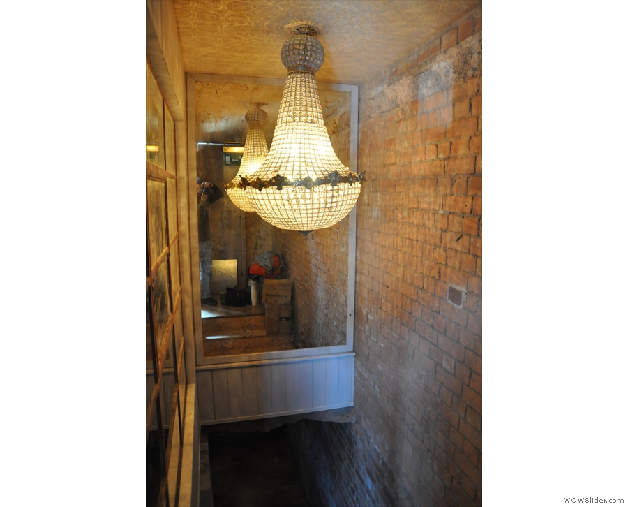 Revealing a secret passageway with an amazing light-fitting (and another mirror)...