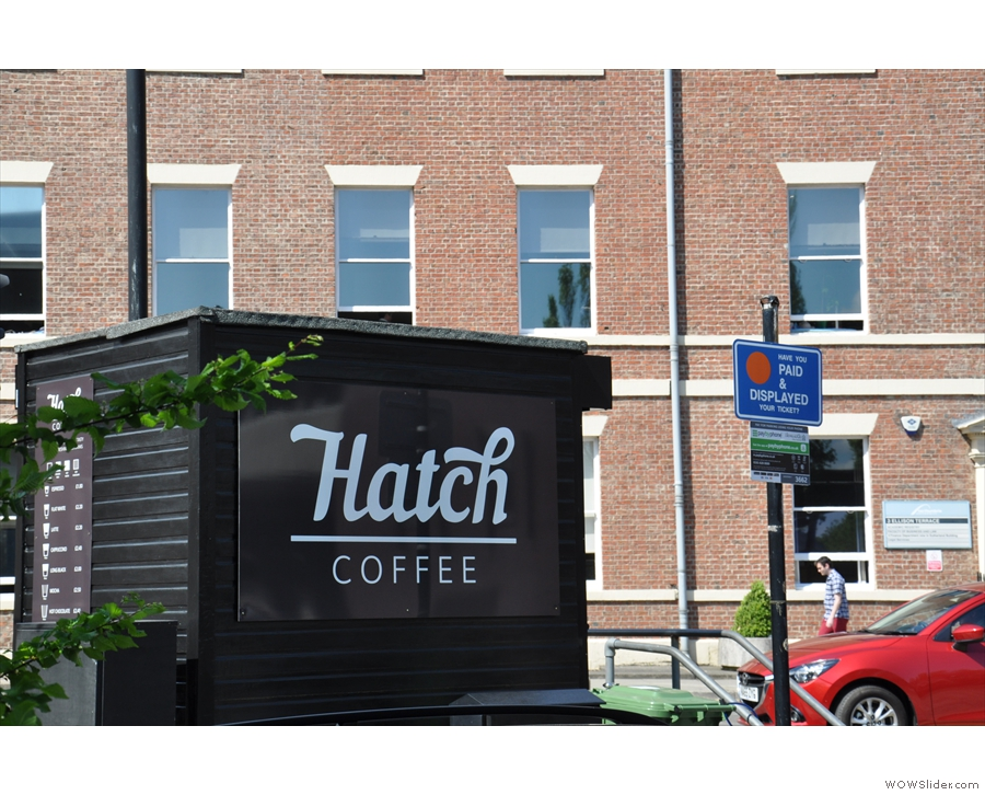 The small, black hut, once occupied by the car park attendent, is now home to Hatch Coffee.