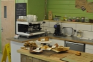 The cakes, with the espresso machine behind. Both are worth a closer look.