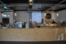 The counter itself, the heart of Bunker, with the open kitchen behind it.