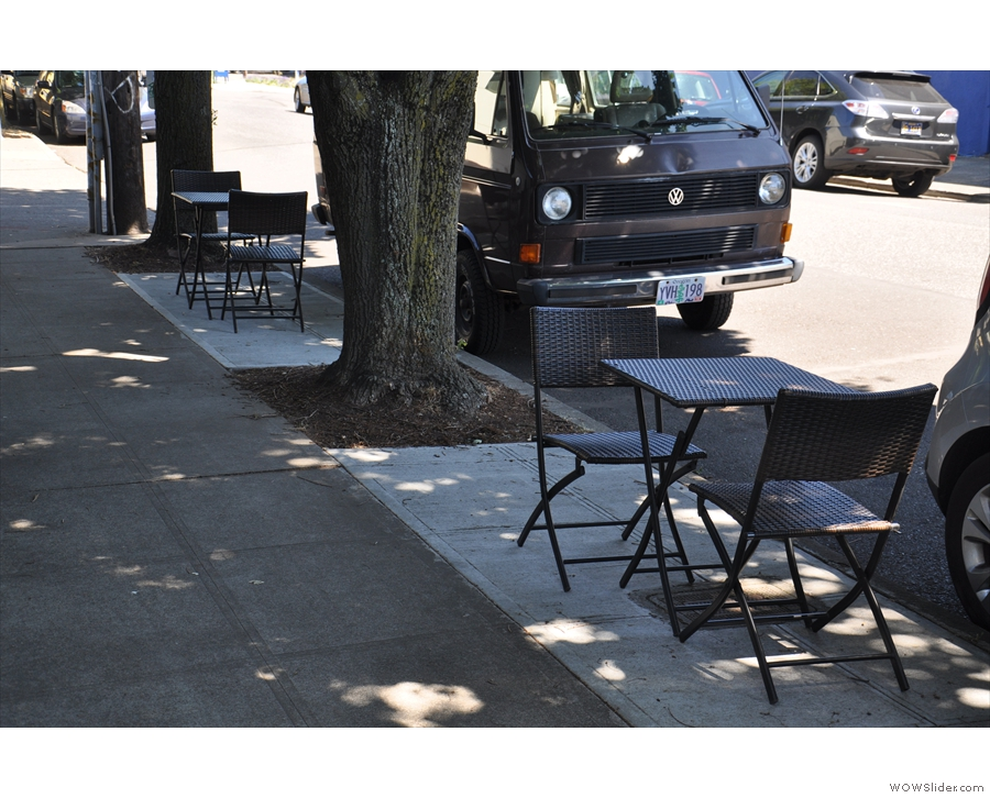 There are a couple of tables out here on the edge of the pavement...