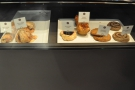 A tasty-looking but limited cake and sandwich selection.