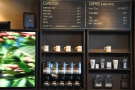 The actual coffee menu is on the wall to the right, along with the retail shelves.