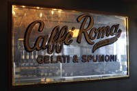 "A mirror from the wall of Caffe Roma, New York City, with the slogan ""Caffe Roma, Gelatic & Spumoni"""