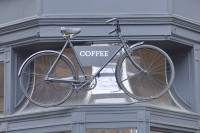The famous TAP bicycle above the door at the No. 114 branch on Tottenham Court Road