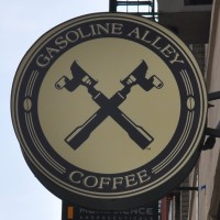 The Gasoline Alley Logo, crossed-espresso baskets