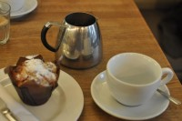 Filter Coffee from Notes, served in a silver coffee pot, plus a muffin.