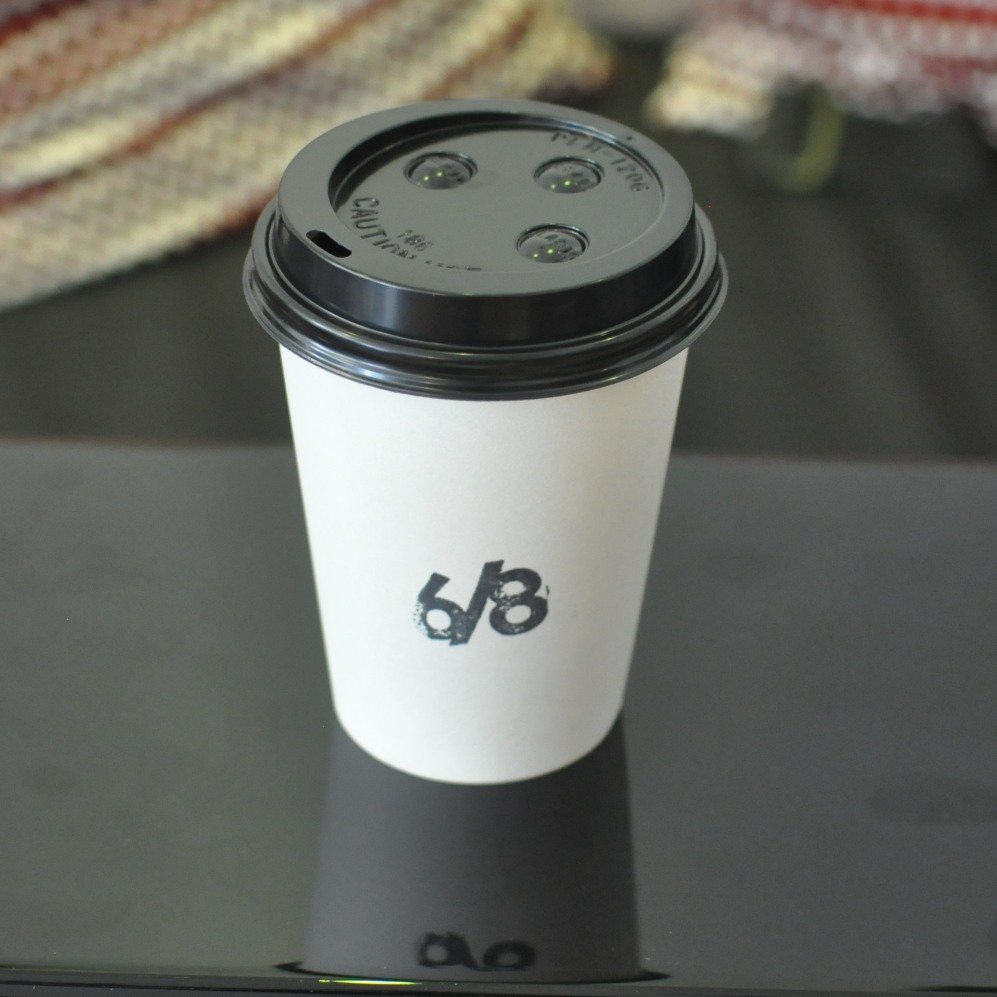 A 6/8 Kafe takeaway cup