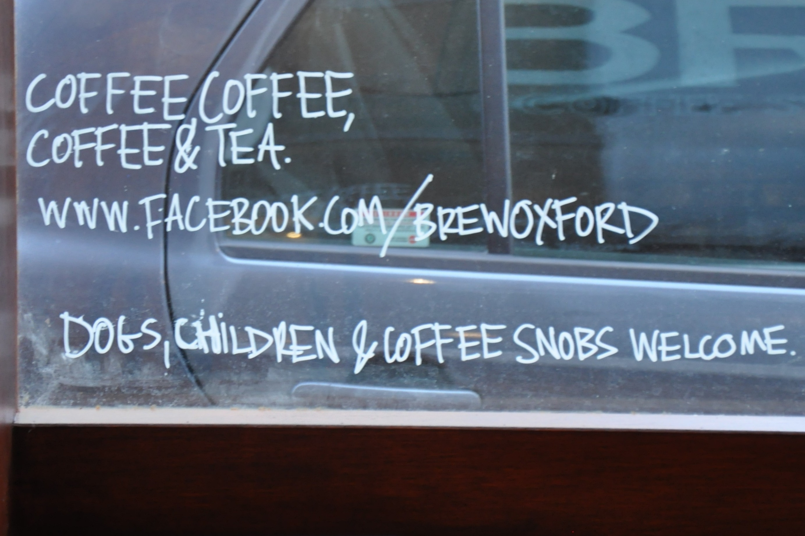 "The writing on the window says all I need to know about Brew's attitude: ""Coffee, Coffee, Coffee & Tea. Dogs, Children & Coffee Snobs Welcome."""