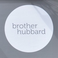The Brother Hubbard logo: 'brother hubbard' in a large, white circle.