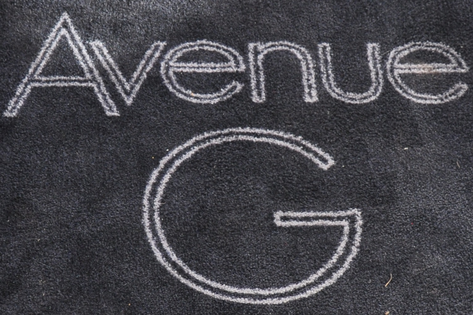 """The words """"Avenue G"""" in white on black."""