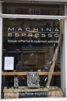 The window Edinburgh's Machina Espresso, showing off some of the wares, including cups, grinders and espresso machines.