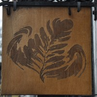 The trademark Papercup leaf from the sign hanging outside.