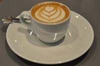 A beautiful piccolo from Saint Kitchen, using Extract Coffee, made in an espresso cup with an over-sized saucer.