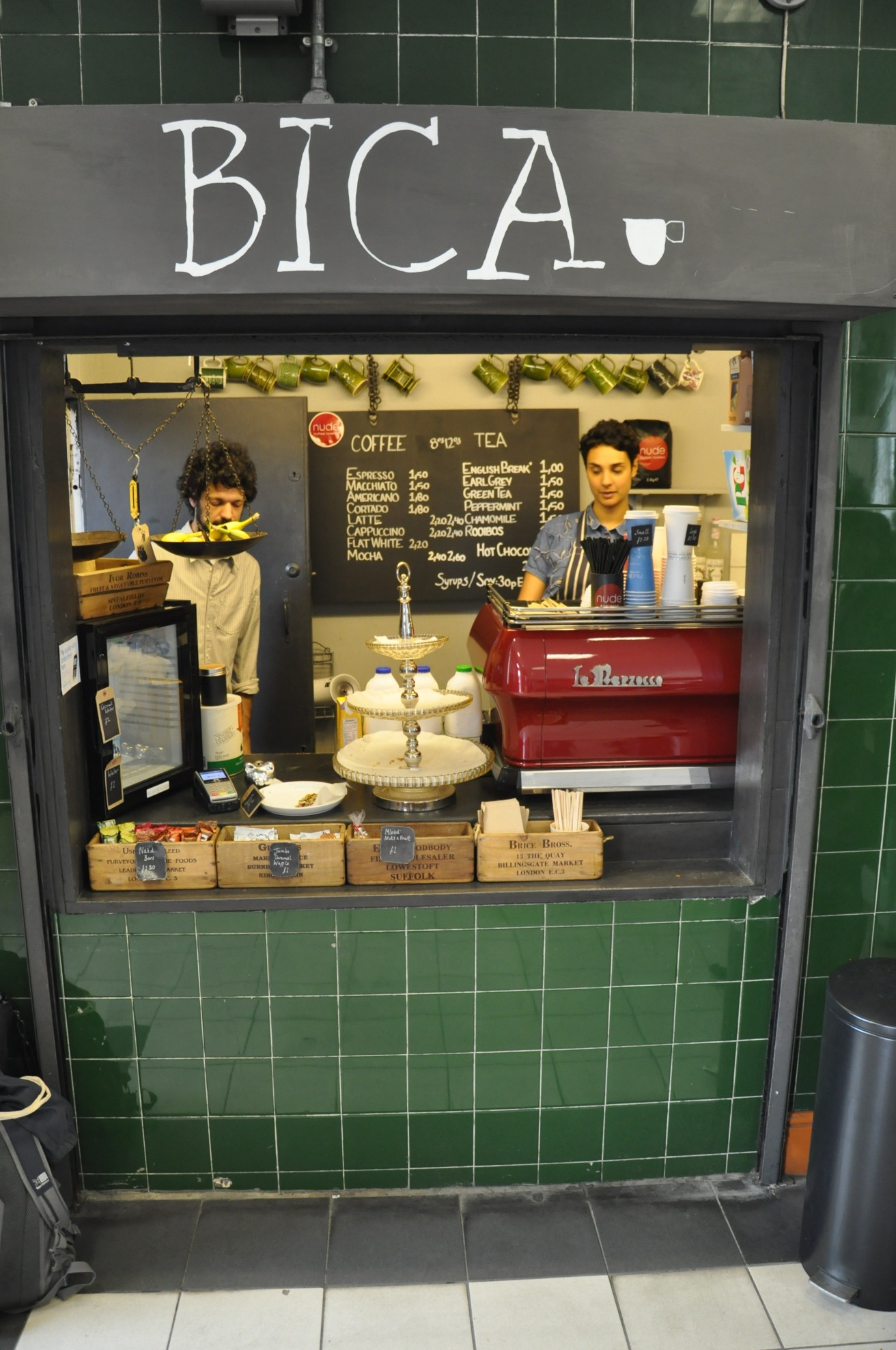 Bica, at Westbourne Park Station. A small serving hatch surrounding by green tiles.