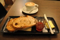 A flat white and two slices of sour dough toast for breakfast at Laynes Espresso. Plus jam in a glass!