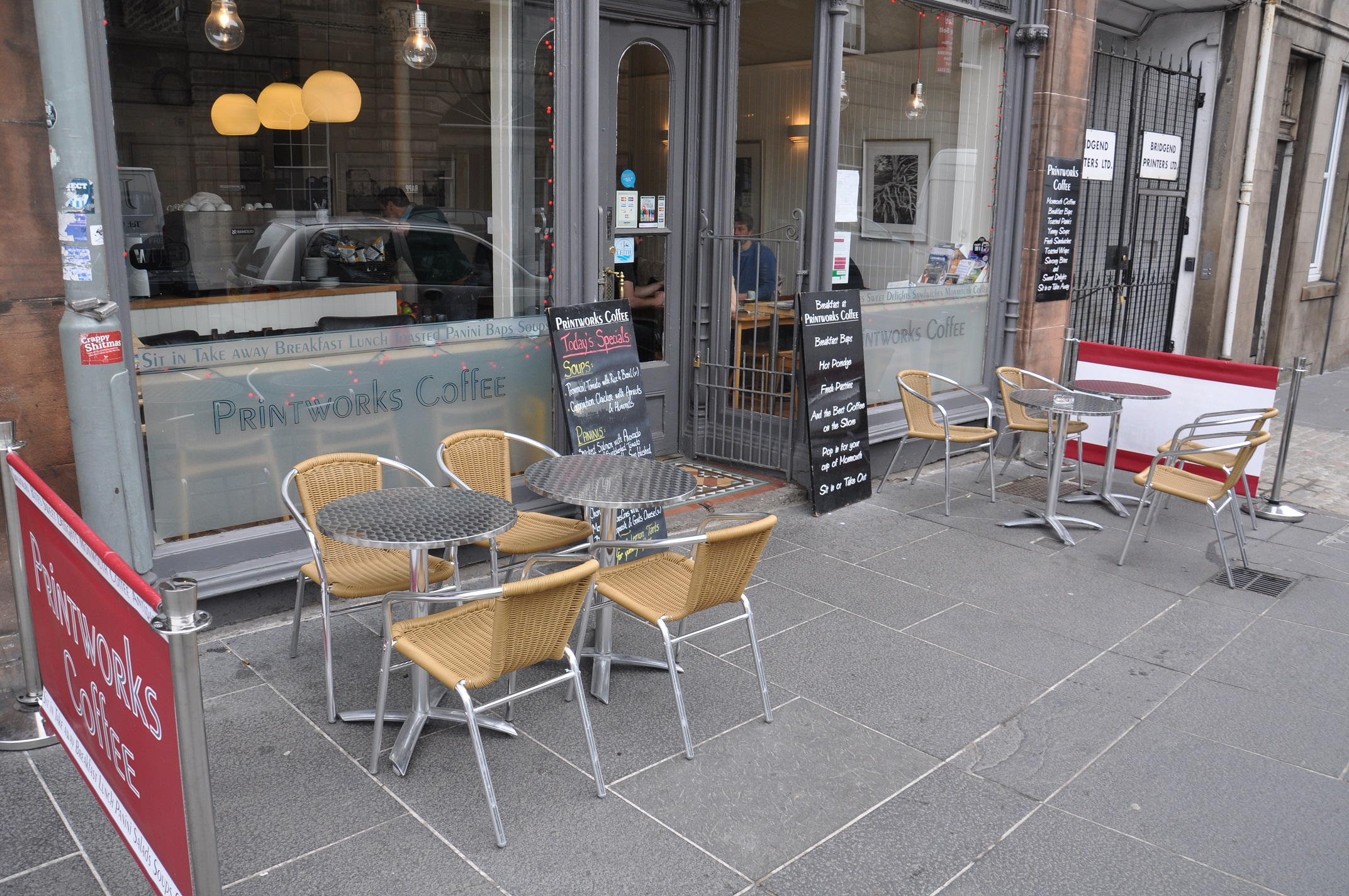A shot of Printworks Coffee Shop in Leith showing the outside seating on the pavement in front of the shop.