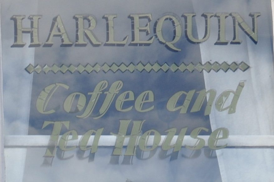 Harlequin Coffee and Tea House, as written in the first floor window facing onto the street.