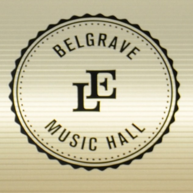 "The letters ""LE"" for Laynes Espresso in black on white, in the centre of a black circle with the words ""Belgrave Music Hall"" around the edge."