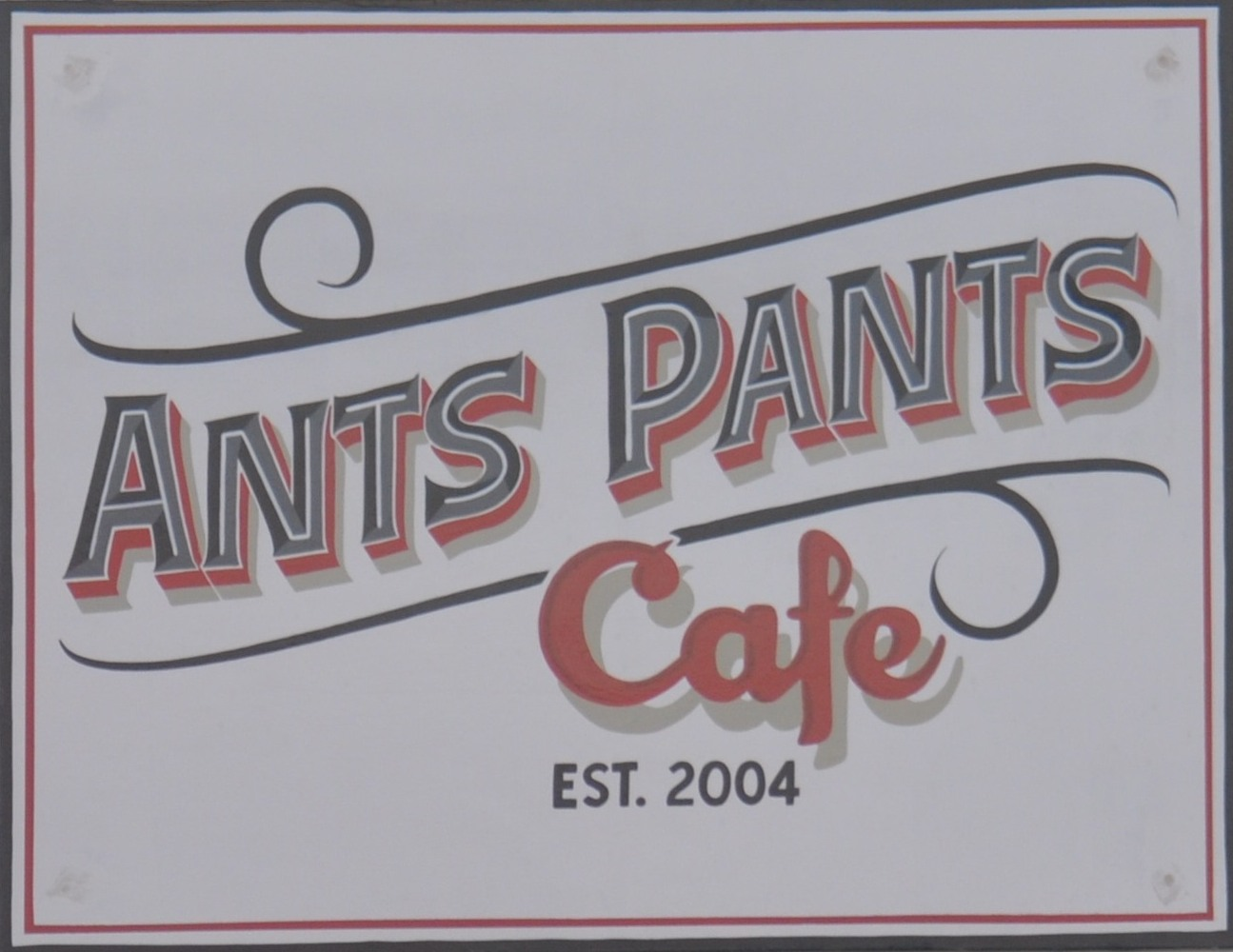 "The text ""Ants Pants Cafe"" over the date the cafe was established: 2004"