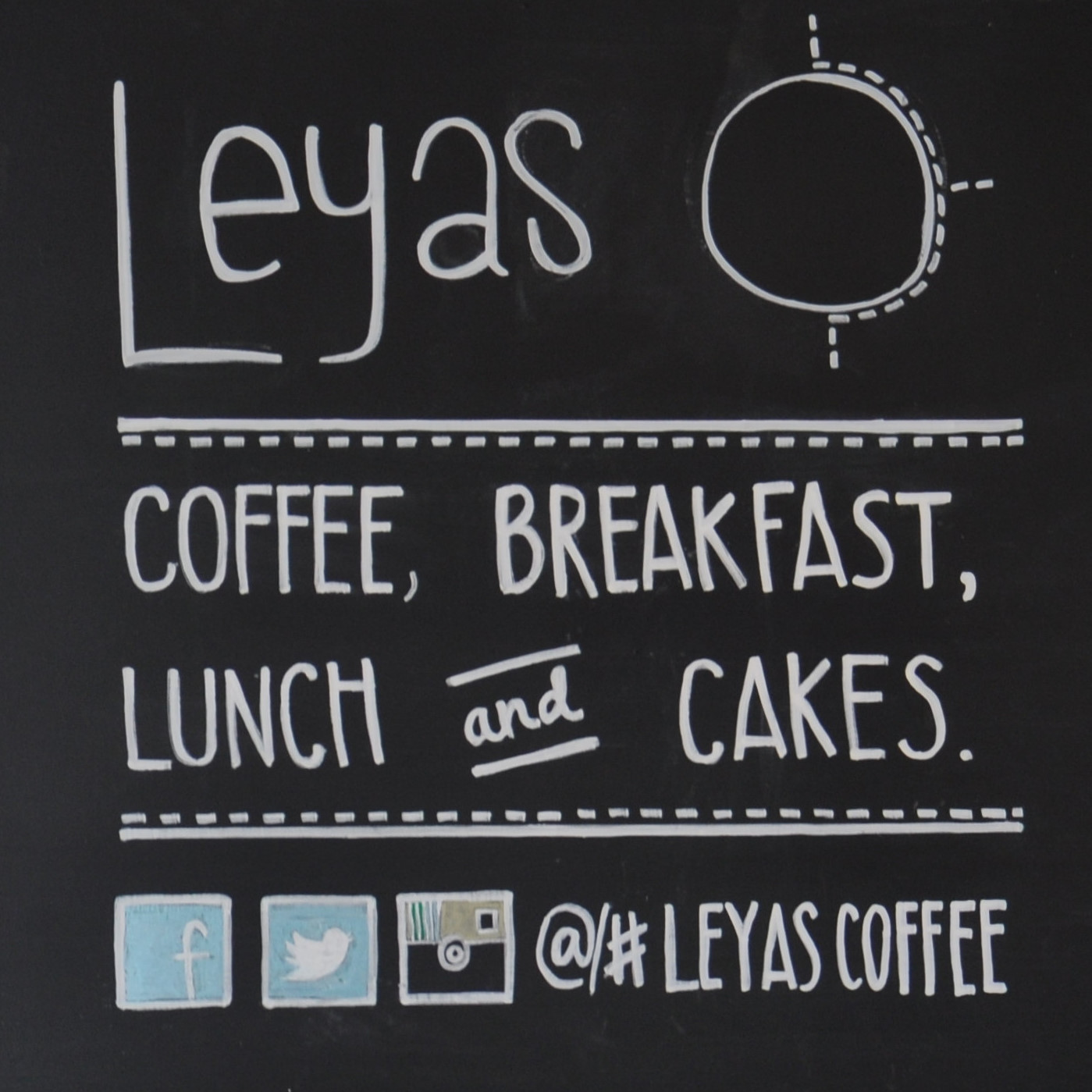 A chalkboard inside Leyas on Camden High Street, offering coffee, breakfast, lunch and cakes.