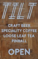 The Tilt A-board, proudly displaying Tilt's credentials: craft beer, speciality coffee, loose-leaf tea and pinball. Naturally.