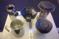 My coffee travel kit on my BA flight to Newark: mini Porlex grinder, Aeropress, plus funnel, metal jug and Upper Cup