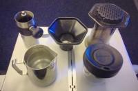 My coffee travel kit on my BA flight to Newark: mini Porlex grinder, Aeropress, plus funnel, metal jug and Upper Cup