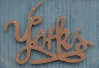 Detail of the Yorks sign which used to hang above the door at Yorks Bakery Cafe, Stephenson Street, and now occupies the back wall of the newly expanded Yorks Cafe & Coffee Roasters.