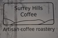 The Surrey Hills Coffee logo from the back wall of the coffee shop on Chapel Street, Guildford.