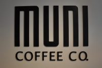 The Muni Coffee Co. logo from the wall behind the counter at the Fulham Road coffee shop.