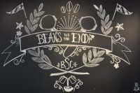 "The Blue State Coffee motto, ""Beans to an End"", from a framed drawing on the wall of the Theyer Street branch in Providence."