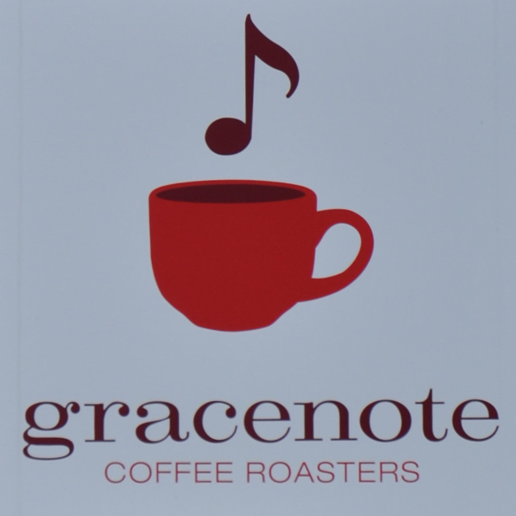 """A drawing of a musical note, over a drawing of a coffee cup, over the words """"gracenote 