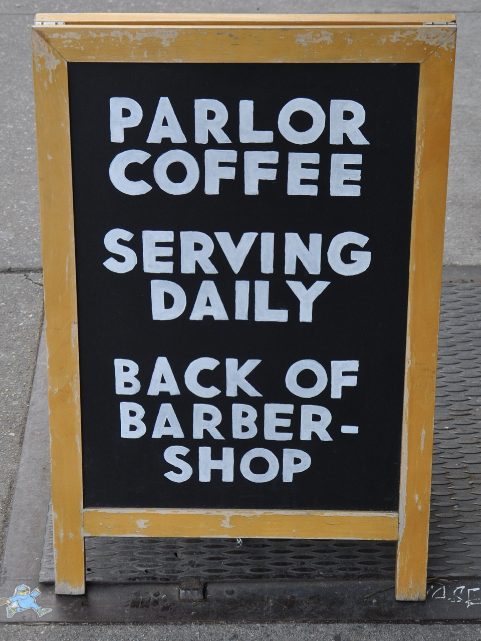 "A simple blackboard with ""Parlor Coffee 