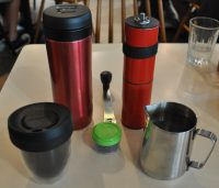 My new travel kit: from left to right, starting at the top: Espro Travel Press, feldfarb grinder from Knock, UpperCup reusable cup and metal pouring jug.