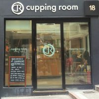 The square facade of The Cupping Room in Central, facing onto the steeply-sloping Cochrane Street.