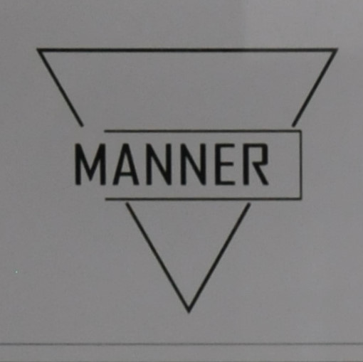 """The word """"Manner"""" written partly across an inverted triangle."""